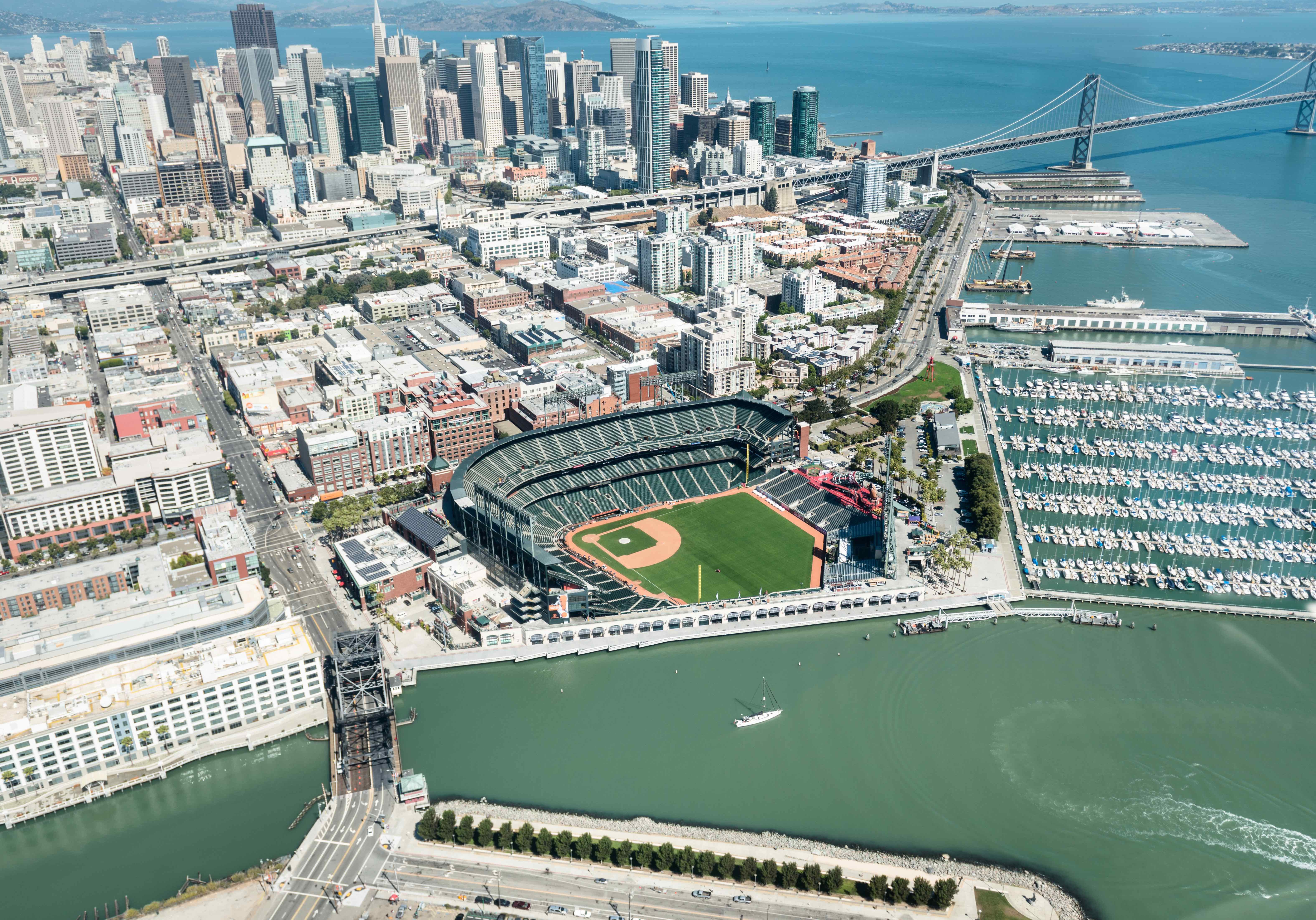 San Francisco, California, USA - August 29, 2012: Aerial view of the Baseball AT+T Park stadium in the north district area of San Francisco. This is the stadium of the San Francisco Giants baseball team. Image taken from the helicopter during a sunny day. In the background is visible the San Francisco downtown area with skyscraper.